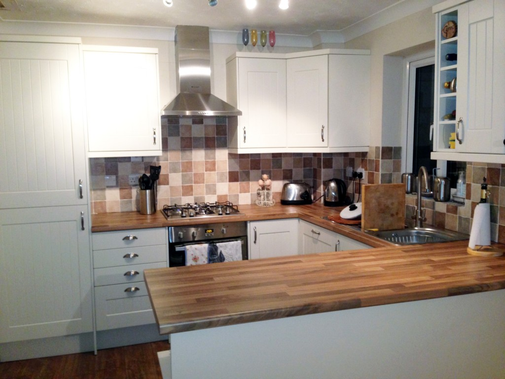 Kitchen fitting by Ashco building and maintenance services.